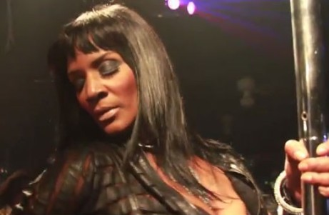 Momma Dee dances on a stripper pole